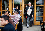 Restaurant maitre d' Greig Pirie, father of chef and owner, Gayle Pirie, walks customers to their table in the patio of Foreign Cinema, in San Francisco, CA., on Friday, June 12, 2009..