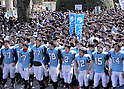 March 10, 2011, Tokyo, Japan - Tokyo University students in football uniform lead the way as Japan top-notch school announces the results of the second phase of its entrance examinations on the Hongo campus in Tokyo on Thursday, March 10, 2011. A total of 3009 applicants passed the exams to be enrolled by the nation's most prestigious institution. (Photo by Natsuki Sakai/AFLO) [3615] -mis-