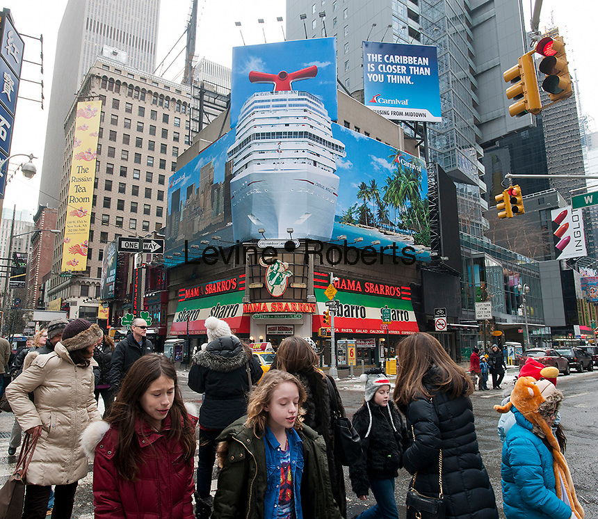 A billboard on Broadway in New York advertises Carnival Cruises excursions to the Caribbean, seen on Sunday, January 22, 2012. Vacationers are expected to book less cruises this winter because of the Costa Concordia tragedy in Italian waters.   (© Richard B. Levine)