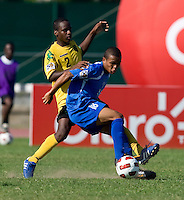 Oshane Jenkins (2) of Jamaica fights for possession with Carlos Andrade (18) of Honduras during the quarterfinals of the CONCACAF Men's Under 17 Championship at Catherine Hall Stadium in Montego Bay, Jamaica. Jamaica defeated Honduras, 2-1.