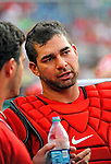 9 July 2011: Washington Nationals catcher Jesus Flores chats in the dugout during a game against the Colorado Rockies at Nationals Park in Washington, District of Columbia. The Nationals were edged out by the Rockies 2-1, dropping the second game of their 3-game series. Mandatory Credit: Ed Wolfstein Photo