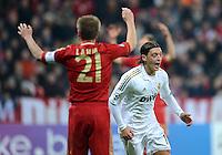 FUSSBALL   CHAMPIONS LEAGUE  HALBFFINAL HINSPIEL   2011/2012      FC Bayern Muenchen - Real Madrid          17.04.2012 Jubel nach dem Tor zum 1:1:  Mesut Oezil (re, Real Madrid). Philipp Lahm (li, FC Bayern Muenchen)   wendet sich enttaeuscht ab