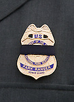 A black-tapped badge honors National Park Service Ranger Margaret Anderson during a memorial service at the Pacific Lutheran University in Tacoma on January 10, 2010.  Anderson, was slain at Mount Rainier on New Years' Day when she set up a road block to intercept a vehicle, driven by Benjamin Barnes, who failed to stop at a chain-up checkpoint.  Barnes, the suspect  in the shooting was found dead was found dead the next day. He had drown in Paradise Creek.  ©2012. Jim Bryant Photo. All Rights Reserved.