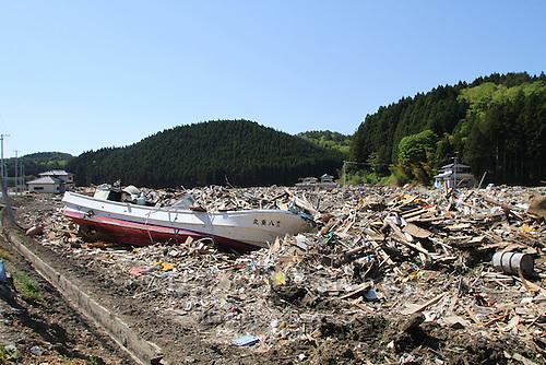 May 18, 2011; Minamisanriku, Miyagi Pref., Japan - 1.2 kilometers inland, a fishing boat sits amongst splintered wood and debris after the magnitude 9.0 Great East Japan Earthquake and Tsunami that devastated the Tohoku region of Japan on March 11, 2011.