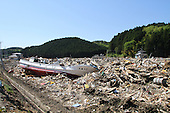 May 18, 2011; Minamisanriku, Miyagi Pref., Japan - 1.2 kilometers inland, a fishing boat sits amongst splintered wood and debris after the magnitude 9.0 Great East Japan Earthquake and Tsunami that devastated the Tohoku region of Japan on March 11, 2011.