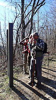 NWA Democrat-Gazette/FLIP PUTTHOFF <br /> Hikers Karen Mowry (from left) Tom Mowry and Gene Williams look at a trail map Jan. 29, 2016 before starting a Goat Trail hike.