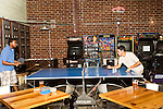 June 25, 2015. Durham, North Carolina.<br />  (left to right) James Mwalali and Enrico Boarati play  spirited game of ping pong at Fullsteam Brewery.<br /> Fullsteam Brewery, in the Central Park District of Durham, has become a neighborhood hub for food trucks, entertainment, and those who enjoy them.