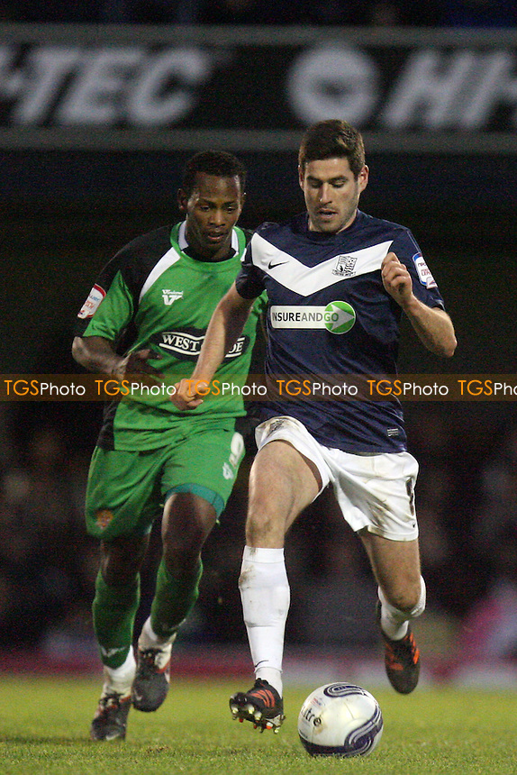Michael Timlin of Southend and Jon Nurse of Dagenham and Redbridge - Southend vs Dagenham - at the Roots Hall Stadium - 02/01/12 - MANDATORY CREDIT: Dave Simpson/TGSPHOTO - Self billing applies where appropriate - 0845 094 6026 - contact@tgsphoto.co.uk - NO UNPAID USE.