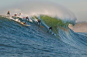 Surfers riding wave, Mavericks, Monterey Bay, California