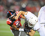 Ole Miss defensive back Frank Crawford (5) hits Texas'  David Ash (14) at Vaught-Hemingway Stadium in Oxford, Miss. on Saturday, September 15, 2012. Texas won 66-21. Ole Miss falls to 2-1.