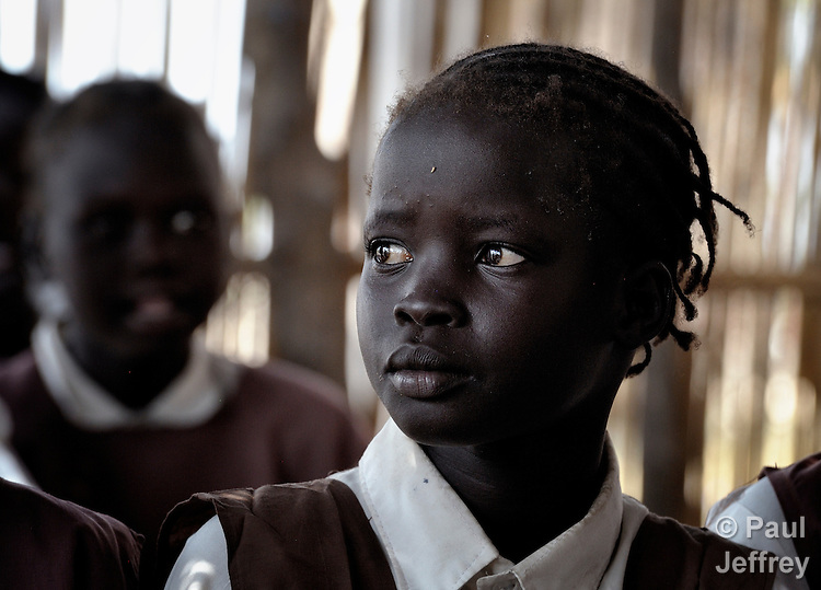 A girl in a classroom in Detang, a small village across the Upper Nile River from Malakal, in Southern Sudan. Teachers in this school are participating in a training program run by Solidarity with Southern Sudan, an international network of Catholic groups supporting Southern Sudan with educational personnel and prayer.
