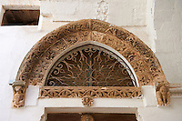 Medieval relief sculptures from 1432 on the Church of San Giacomo di Compostella. .Ostuni, The White Town, Puglia, Italy.