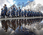 Members of the Massachusetts State Police march in formation as they participate in a walk-by at the the wake for Trooper Thomas Clardy in Hudson on Monday, March 21, 2016. Clardy was killed in the line of duty as a result of an accident on the Massachusetts Turnpike in Charlton last week. Photo by Christopher Evans