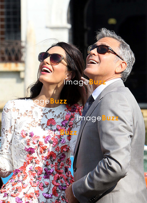 GEORGE CLOONEY AND AMAL ALAMUDDIN FIRST APPEARANCE AS A MARRIED COUPLE!<br /> George Clooney &amp; wife Amal Alamuddin show off their wedding bands as they make first appearance as man and wife. The newlyweds hosted a brunch for family and friends at Hotel Cipriani in Venice. <br /> Italy, Venice, 29 September 2014.