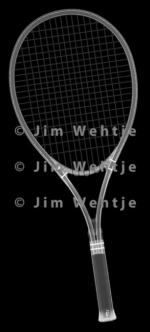 X-ray image of a tennis racket (white on black) by Jim Wehtje, specialist in x-ray art and design images.
