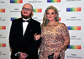 Singer Elle King and fiance Andrew Ferguson arrive for the formal Artist's Dinner honoring the recipients of the 39th Annual Kennedy Center Honors hosted by United States Secretary of State John F. Kerry at the U.S. Department of State in Washington, D.C. on Saturday, December 3, 2016. The 2016 honorees are: Argentine pianist Martha Argerich; rock band the Eagles; screen and stage actor Al Pacino; gospel and blues singer Mavis Staples; and musician James Taylor.<br /> Credit: Ron Sachs / Pool via CNP