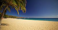 Visitors enjoy the sun, surf and sand at Hulopo'e Beach, Lana'i.