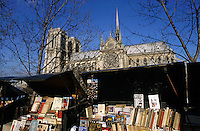 Books on display on a book stall in front of Notre Dame de Paris, Paris, France.