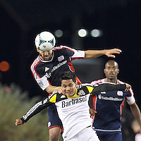 New England Revolution defender A.J. Soares (5) and Columbus Crew forward Jairo Arrieta (25) battle for head ball.  In a Major League Soccer (MLS) match, the New England Revolution (blue) defeated Columbus Crew (white), 3-2, at Gillette Stadium on October 19, 2013.