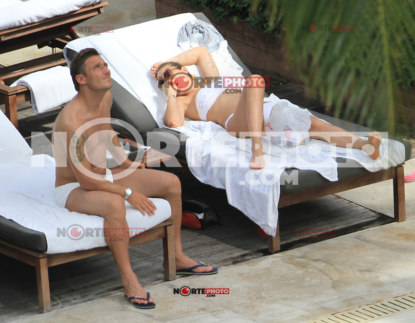 MRPIXX.COM - 07JUNE12.MIAMI BEACH, FLORIDA.Soccer star FRANCESCO TOTTI and wife ILARY BLASI enjoy pool day.NON EXCLUSIVE BY MRPIXX.COM