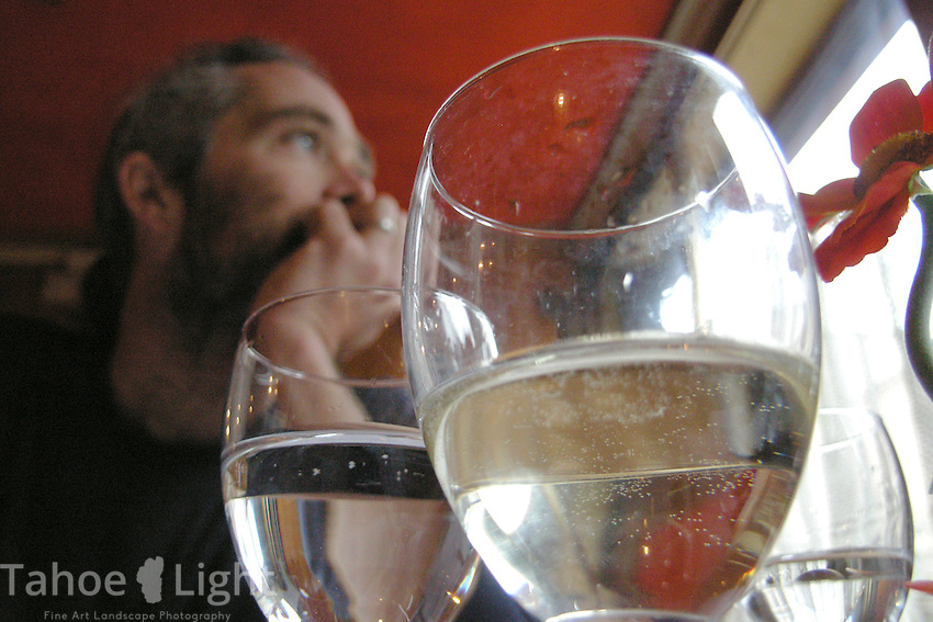 A traveller ponders over a glass of wine inside a Venice, Italy, cafe.