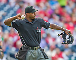21 May 2014: MLB Umpire Alan Porter works a game at Home Plate between the Cincinnati Reds and the Washington Nationals at Nationals Park in Washington, DC. The Reds edged out the Nationals 2-1 to take the rubber match of their 3-game series. Mandatory Credit: Ed Wolfstein Photo *** RAW (NEF) Image File Available ***