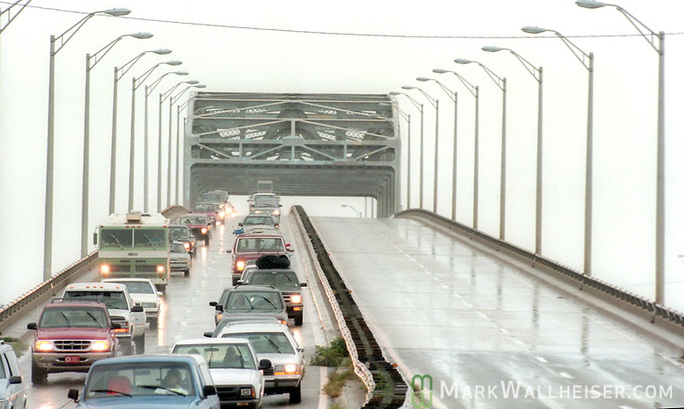 Panama City Beach traffic evacuates over the Hathaway Bridge as Hurricane Opal approaches the Florida panhandle as a category three storm when it came ashore near Pensacola, Florida October 4, 1995.  It was the strongest hurricane of the 1995 season and killed 63 people, 13 in the United States.  Hurricane Opal's name was retired the following year.