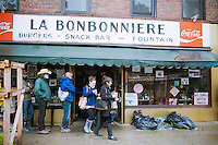 Customers wait in line at La Bonbonniere, one of the few restaurants open because of the power outage, in the New York neighborhood of Greenwich Village after Hurricane Sandy, seen on Tuesday, October 30, 2012. Hurricane Sandy roared into New York disrupting the transit system and causing widespread power outages. Con Edison is estimating it will take four days to get electricity back to Lower Manhattan. (© Richard B. Levine)