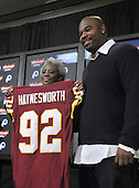 Ashburn, VA - February 27, 2009 -- Linda Haynesworth holds the jersey of her son, Albert Haynesworth, a 6 foot, 6 inch, 320 pound defensive tackle formerly with the Tennessee Titans, as he meets reporters at Redskins Park in Ashburn, Virginia after signing a 100 million dollar contract with the Washington Redskins on Friday, February 27, 2009.  Since he came into the NFL in 2002, Haynesworth has posted 271 tackles (199 solo) and 24 quarterback sacks.  He was elected to the Pro Bowl following the 2007 and 2008 seasons..Credit: Ron Sachs / CNP
