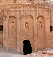 Roman Soldier's tomb, 200 BC- 200 AD, Petra, Ma'an, Jordan. These tombs were carved by the Nabateans in the face of Jabal al-Khubtha, the mountain overlooking Petra on the East. Originally behind a courtyard, the facade of this tomb is decorated with engaged pilasters and columns that frame three niches with the statue of a military officer in the central niche. Petra was the capital and royal city of the Nabateans, Arabic desert nomads. Picture by Manuel Cohen
