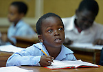 A refugee boy in class in a school operated by St. Andrew's Refugee Services in Cairo, Egypt. Located at St. Andrews United Church of Cairo, the program is supported by Church World Service.