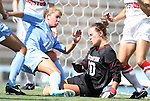 28 August 2011: North Carolina's Kelly McFarlane (11) scores her first collegiate goal past Houston's Sydney George (00). The University of North Carolina Tar Heels defeated the University of Houston Cougars 6-1 at Fetzer Field in Chapel Hill, North Carolina in an NCAA Women's Soccer game.
