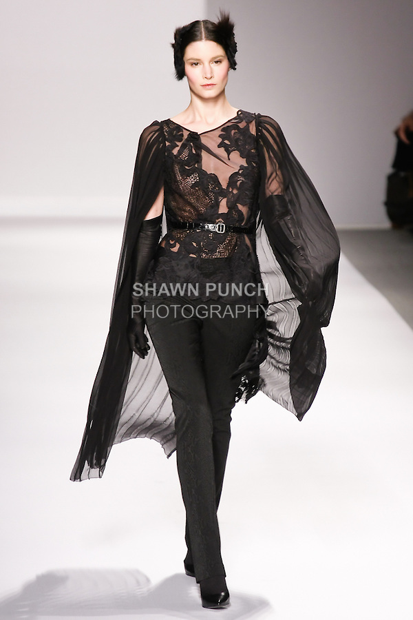 Marija Vujovic walks runway in an outfit from the Elie Tahari Fall 2011 collection, during Mercedes-Benz Fashion Week Fall 2011.