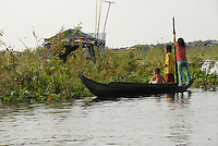 Children play at along the floating village near Siem Reap, Cambodia. The Vietnamese floating villagers on branches of Lake Tonie Sap, Cambodia are a unique nomadic community. With permission from the Cambodian government, they have built an entire floating community of houseboats, churches, clinics, shops and community centers on the river near Siem Reap, Cambodia. As the seasons change and the tides shift the entire village changes its location. The villagers rely on sales of fruits and soft drinks to the many tourists who have come by boat to see firsthand the hardships of life on a floating village. The Vietnamese are the most vulnerable of Cambodia's minorities, and the most prone to discrimination and violations of their rights.