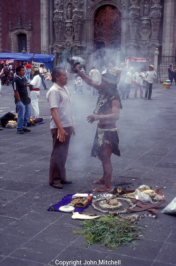 Indian shaman performing a limpia or traditional cleansing in the Zocalo, Mexico City, Mexico