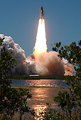 Kennedy Space Center, FL - July 4, 2006 -- Space Shuttle Discovery kicks off the Fourth of July fireworks with its own fiery display as it rockets into the blue sky, spewing foam and smoke over the ground, on mission STS-121. It was the third launch attempt in four days; the others were scrubbed due to weather concerns. Liftoff was on-time at 2:38 p.m. EDT. During the 12-day mission, the STS-121 crew of seven will test new equipment and procedures to improve shuttle safety, as well as deliver supplies and make repairs to the International Space Station. Landing is scheduled for July 17 at Kennedy's Shuttle Landing Facility. .Credit: Sandy Joseph and Robert Murray - NASA via CNP