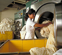 Hispanic woman in commercial laundry