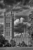 Looking across the lawn at the Parliament Buildings in London England in black and white.