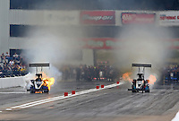 Sep 28, 2013; Madison, IL, USA; NHRA top fuel dragster driver Tim Cullinan (left) has a fire alongside Scott Palmer during qualifying for the Midwest Nationals at Gateway Motorsports Park. Mandatory Credit: Mark J. Rebilas-