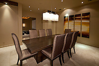 Large empty dining table is seen in ultra modern home at night