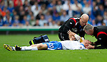 Rangers v St Johnstone....28.08.10  .Murray Davidson receives treatment after a head knock.Picture by Graeme Hart..Copyright Perthshire Picture Agency.Tel: 01738 623350  Mobile: 07990 594431
