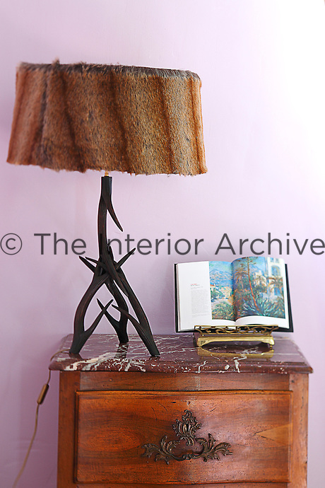 In one of the bedrooms there is an unusual bedside lamp made of antlers with a fur lampshade