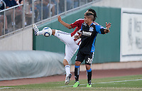 Carlos Borja tries to kick the ball against Javier Robles (30). The San Jose Earthquakes defeated Chivas USA 6-5 in shootout after drawing 0-0 in regulation time to win the inagural Sacramento Cup at Raley Field in Sacramento, California on June 12, 2010.