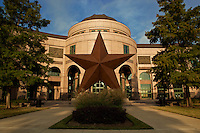 "The Bob Bullock Texas State History Museum in downtown Austin, Texas, tells the ""Story of Texas"" with three floors of interactive exhibits, the special effects show, The Star of Destiny, in the Texas Spirit Theater, and Austin's only IMAX Theatre, featuring the signature large-format film, Texas: The Big Picture. A 35-foot-tall bronze Lone Star sculpture greets visitors in front of the Museum, and a colorful terrazzo floor in the Museum's rotunda features a campfire scene with enduring themes from Texas' past. The Museum also has a Cafe with indoor and outdoor seating and a Museum Store with something for the Texan in everyone."