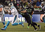 Seattle Seahawks  defensive end Michael Bennett (72) lunges for Carolina Panthers quarterback Kam Newton (2) during the NFC Western Division Playoffs at CenturyLink Field  on January 10, 2015 in Seattle, Washington. The Seahawks beat the Panthers 31-17. ©2015. Jim Bryant Photo. All Rights Reserved.