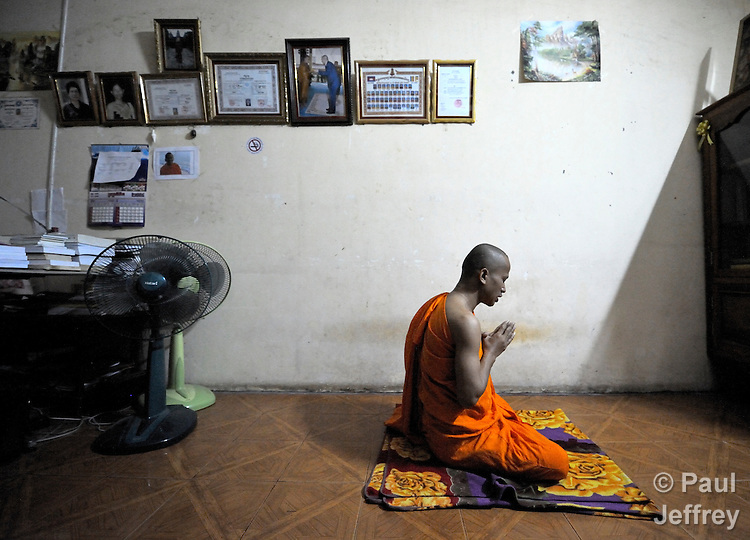 Eath Buntheng, a Buddhist monk in Phnom Penh who is active in helping people living with HIV and AIDS and an outspoken critic of stigma and discrimination, meditates in his office at the Wat Toul Tompong early in the morning. He is one of many monks who works with the Salvation Centre Cambodia in teaching meditation techniques to people living with the virus.