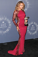 INGLEWOOD, CA, USA - AUGUST 24: Singer Beyonce, recipient of the Michael Jackson Video Vanguard Award and Video Music Awards for Best Collaboration, Best Cinematography, and Best Video with a Social Message, poses in the press room at the 2014 MTV Video Music Awards held at The Forum on August 24, 2014 in the Inglewood, California, United States. (Photo by Xavier Collin/Celebrity Monitor)