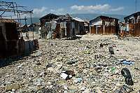 Shacks and garbage in the slum of Cité Soleil, Port-au-Prince, Haiti, 11 July 2008. Cité Soleil is considered one of the worst slums in the Americas, most of its 300.000 residents live in extreme poverty. Children and single mothers predominate in the population. Social and living conditions in the slum are a human tragedy. There is no running water, no sewers and no electricity. Public services virtually do not exist - there are no stores, no hospitals or schools, no urban infrastructure. In spite of this fact, a rent must be payed even in all shacks made from rusty metal sheets. Infectious diseases are widely spread as garbage disposal does not exist in Cité Soleil. Violence is common, armed gangs operate throughout the slum.