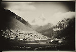The settlement of Namche Bazar and (center back) Ama Dablam, a mountain in the Himalaya range of eastern Nepal.
