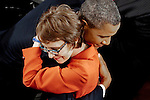 President Barack Obama hugs former Rep. Gabrielle Giffords on the floor of the U.S. House of Representatives before delivering his third State of the Union address to a joint session of Congress on Tuesday night. Obama spoke about keeping alive the American dream and pledged to fight obstruction by congressional Republicans.
